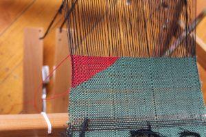 Close up detail of SAORI weaving on loom.