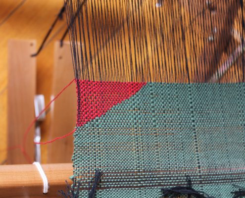 Close up detail of SAORI weaving on loom.