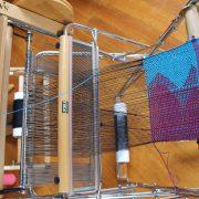 SAORI weaving on a loom.