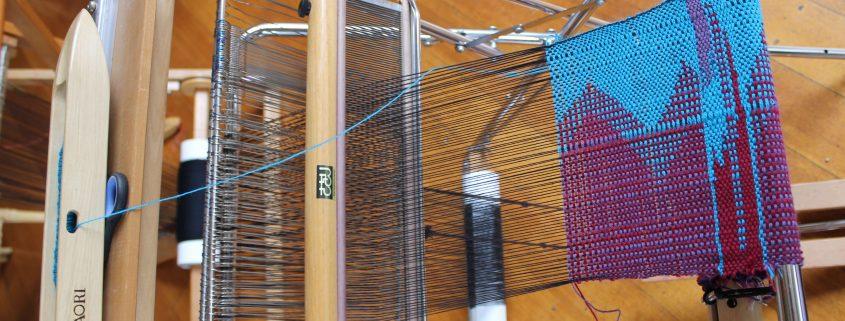 SAORI weaving on a loom at Shizuka Ryokan