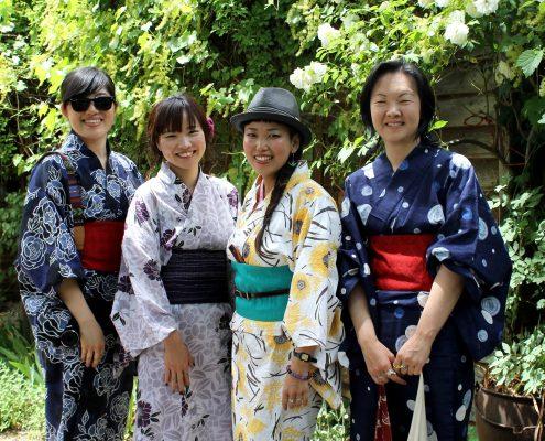 Four people wearing summer kimonos